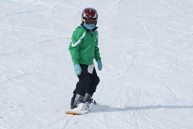 Dítě na snowboardu